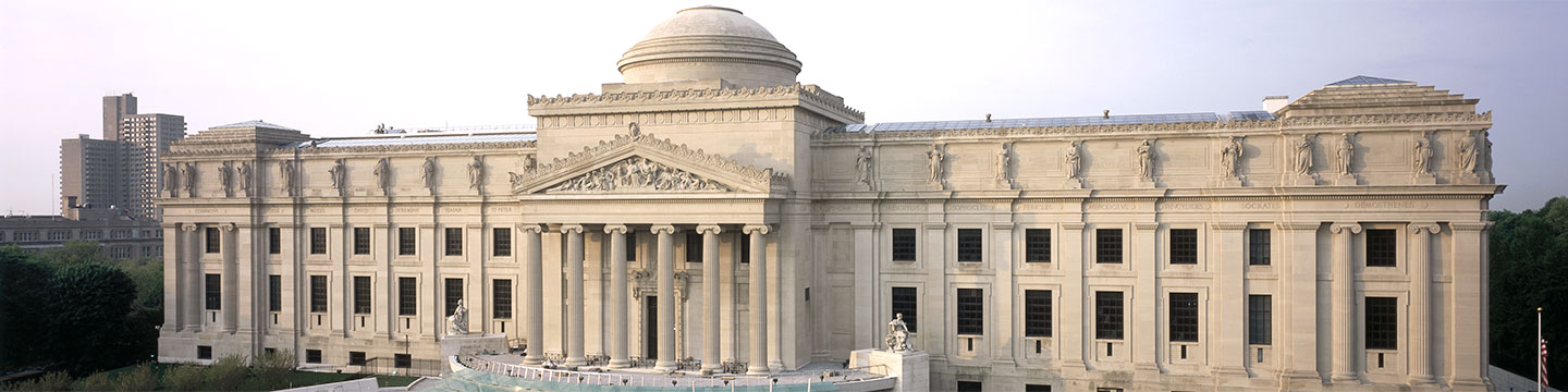 Daytime view of the front of the Brooklyn Museum building, taking in the entire facade