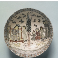 <p><i>Bowl (Enthronement Scene)</i>. Iran. Seljuq dynasty, late 12th-early 13th century. Ceramic, <i>mina'i</i> or <i>haft rangi</i> (seven-color) ware; frit body, opaque glaze with in-glaze painting, overglaze painting, and leaf gilding, 3<sup>3</sup>⁄<sub>16</sub> x 8<sup>1</sup>⁄<sub>4</sub> in. (8.1 x 21 cm). Brooklyn Museum, Gift of the Ernest Erickson Foundation, Inc., 86.227.61</p>