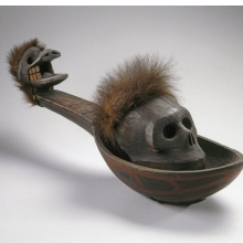 <p>Heiltsuk artist. <i>Ladle with Skull</i>, 19th century. Wáglísla, British Columbia, Canada. Cedar wood, bear fur, cord, pigment, 29 x 8<sup>3</sup>⁄<sub>4</sub> x 9<sup>5</sup>⁄<sub>16</sub> in. (73.7 x 22.2 x 23.6 cm). Brooklyn Museum, Museum Expedition 1905, Museum Collection Fund, 05.588.7297a–b</p>