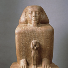 <p><em>Block Statue of Senwosret-senebnefny</em>. Egypt, exact provenance not known. Middle Kingdom, late Dynasty 12, circa 1836–1759 <small>B.C.E.</small> Quartzite, 26<sup>7</sup>⁄<sub>8</sub> x 16<sup>5</sup>⁄<sub>16</sub> x 18<sup>1</sup>⁄<sub>8</sub> in. (68.3 × 41.5 × 46 cm). Brooklyn Museum, Charles Edwin Wilbour Fund, 39.602</p>
