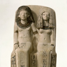 <p><em>Pair Statue of Nebsen and Nebet-ta</em>. Egypt, possibly from Dahamsha. New Kingdom, Dynasty 18, early in the reign of Amunhotep III, circa 1400–1352 <small>B.C.E.</small> Limestone, painted, 15<sup>3</sup>⁄<sub>4</sub> x 8<sup>9</sup>⁄<sub>16</sub> x 9<sup>1</sup>⁄<sub>4</sub> in. (40 × 21.8 × 23.5 cm). Brooklyn Museum, Charles Edwin Wilbour Fund, 40.523</p>