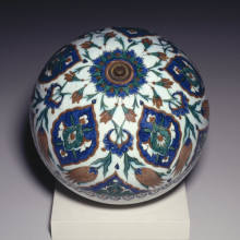 <p><i>Spherical Hanging Ornament</i>. Turkey, Iznik. Ottoman dynasty, 1575–85. Ceramic; fritware, painted in black, cobalt blue, green, and red on a white slip ground under a transparent glaze, diameter: 11<sup>15</sup>⁄<sub>16</sub> in. (30.3 cm). Brooklyn Museum, Gift of Mr. and Mrs. Frederic B. Pratt, 43.24.8</p>
