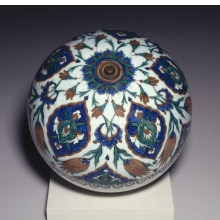 <p><i>Spherical Hanging Ornament</i>. Turkey, Iznik. Ottoman dynasty, 1575&ndash;85. Ceramic; fritware, painted in black, cobalt blue, green, and red on a white slip ground under a transparent glaze, diameter: 11<sup>15</sup>&frasl;<sub>16</sub> in. (30.3 cm). Brooklyn Museum, Gift of Mr. and Mrs. Frederic B. Pratt, 43.24.8</p>