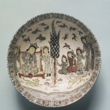 <p><i>Bowl (Enthronement Scene)</i>. Iran. Seljuq dynasty, late 12th-early 13th century. Ceramic, <i>mina'i</i> or <i>haft rangi</i> (seven-color) ware; frit body, opaque glaze with in-glaze painting, overglaze painting, and leaf gilding, 3<sup>3</sup>⁄<sub>16</sub> x 8<sup>1</sup>⁄<sub>4</sub> in. (8.1 × 21 cm). Brooklyn Museum, Gift of the Ernest Erickson Foundation, Inc., 86.227.61</p>