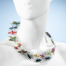 <p>Elsa Schiaparelli (French, born Italy, 1890–1973). <i>Necklace</i>, autumn 1938. Clear Rhodoid (cellulose acetate plastic); metallic green, red, pink, blue, and yellow painted pressed metal ornaments. Brooklyn Museum Costume Collection at The Metropolitan Museum of Art, Gift of the Brooklyn Museum, 2009; Gift of Arturo and Paul Peralta Ramos, 1955 (2009.300.1234)</p>