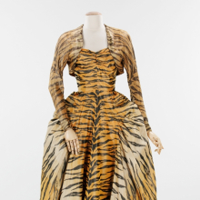 "<p>Gilbert Adrian (American, 1903–1959). <i>""The Tigress"" Evening Ensemble</i>, 1949. Black, beige, and orange silk taffeta chiné; gold lamé. Brooklyn Museum Costume Collection at The Metropolitan Museum of Art, Gift of the Brooklyn Museum, 2009; Gift of Janet Gaynor Adrian, 1963 (2009.300.1297a, b)</p>"