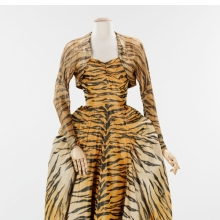 <p>Gilbert Adrian (American, 1903&ndash;1959). <i>&ldquo;The Tigress&rdquo; Evening Ensemble</i>, 1949. Black, beige, and orange silk taffeta chin&eacute;; gold lam&eacute;. Brooklyn Museum Costume Collection at The Metropolitan Museum of Art, Gift of the Brooklyn Museum, 2009; Gift of Janet Gaynor Adrian, 1963 (2009.300.1297a, b)</p>