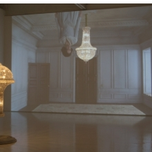 <p>Matthew Buckingham (American, b. 1963). <i>The Spirit and the Letter</i>, 2007. Continuous video projection with sound, electrified chandelier, mirror. Dimensions variable. Courtesy of the artist and Murray Guy, New York</p>
