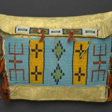 <p>Sioux artist. Storage Bag, late 19th century. Central Plains. Hide, beads, tin cones, horsehair, 15<sup>1</sup>⁄<sub>2</sub> x 20<sup>1</sup>⁄<sub>2</sub> in. (39.4 × 52.1 cm). Brooklyn Museum, Brooklyn Museum Collection, X1111.1</p>