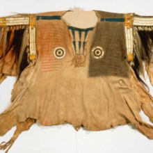 <p>Yanktonai artist. Shirt for Chief's War Dress, early 19th century. Fort Snelling, Minnesota. Buckskin, pony beads, porcupine quills, buckskin, maidenhair fern stems, human hair, horsehair, dye, feather, 44 × 68 in. (111.8 × 172.7 cm). Brooklyn Museum, Henry L. Batterman Fund and the Frank Sherman Benson Fund, 50.67.1a</p>