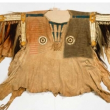 <p>Yanktonai artist. Shirt for Chief's War Dress, early 19th century. Fort Snelling, Minnesota. Buckskin, pony beads, porcupine quills, buckskin, maidenhair fern stems, human hair, horsehair, dye, feather, 44 &#215; 68 in. (111.8 &#215; 172.7 cm). Brooklyn Museum, Henry L. Batterman Fund and the Frank Sherman Benson Fund, 50.67.1a</p>