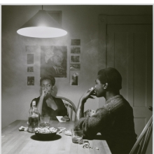 <p>Carrie Mae Weems (American, b. 1953). <em>Untitled (Man Smoking/Malcolm X)</em>, from the <em>Kitchen Table</em> series, 1990. Gelatin silver photograph, sheet: 31<sup>1</sup>&frasl;<sub>4</sub> x 30<sup>7</sup>&frasl;<sub>8</sub> in.; image: 27 &times; 27 in. Brooklyn Museum, Caroline A. L. Pratt Fund, 1991.168</p>