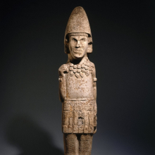 <p>Huastec. <i>Warrior Figure</i>, 13th or 14th century. Sandstone, 65<sup>3</sup>⁄<sub>16</sub> x 14<sup>3</sup>⁄<sub>4</sub> x 7<sup>1</sup>⁄<sub>2</sub> in. (165.6 × 37.5 × 19.1 cm). Brooklyn Museum, Frank L. Babbott Fund, 39.371</p>