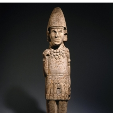 <p>Huastec. <i>Warrior Figure</i>, 13th or 14th century. Sandstone, 65<sup>3</sup>&frasl;<sub>16</sub> x 14<sup>3</sup>&frasl;<sub>4</sub> x 7<sup>1</sup>&frasl;<sub>2</sub> in. (165.6 &times; 37.5 &times; 19.1 cm). Brooklyn Museum, Frank L. Babbott Fund, 39.371</p>