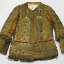 <p><em>Jacket from Man's Festival Costume</em>, 18th century. Cotton, velvet, bark strips, metallic threads, and beads, 32 x 3 x 27<sup>1</sup>/<sub>2</sub> in. (81.3 x 7.6 x 69.9 cm). Brooklyn Museum, Museum Expedition 1941, Frank L. Babbott Fund, 41.1275.274a</p>