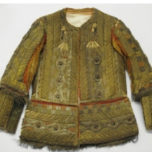 <p><em>Jacket from Man&#39;s Festival Costume</em>, 18th century. Cotton, velvet, bark strips, metallic threads, and beads, 32 x 3 x 27<sup>1</sup>/<sub>2</sub> in. (81.3 x 7.6 x 69.9 cm). Brooklyn Museum, Museum Expedition 1941, Frank L. Babbott Fund, 41.1275.274a</p>