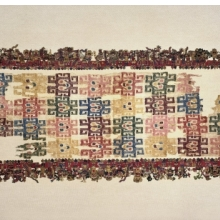 <p>Nasca artists. <i>Mantle, known as the Paracas Textile</i>, 100&ndash;300. Peru. Cotton, camelid fiber, 24<sup>1</sup>&frasl;<sub>2</sub> x 58<sup>1</sup>&frasl;<sub>4</sub> in. (62.2 &times; 148 cm). Brooklyn Museum, John Thomas Underwood Memorial Fund, 38.121</p>