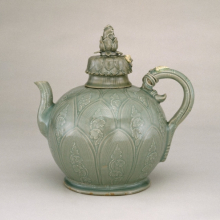 <p><em>Celadon Ewer</em>. Korea. Koryŏ dynasty, first half of the 12th century. Stoneware with white and black slip decoration and blue-green glaze, 9<sup>7</sup>⁄<sub>8</sub> x 9<sup>1</sup>⁄<sub>2</sub> x 5<sup>1</sup>⁄<sub>2</sub> in. (25.1 × 24.1 × 14 cm). Brooklyn Museum, Gift of Mrs. Darwin R. James III, 56.138.1a–b</p>