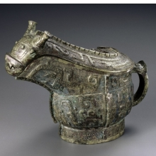 Ritual Wine Vessel (Guang). China, late Shang dynasty, 13th–11th century B.C.E. Bronze, 81⁄2 x 61⁄2 x 4 in. (21.6 × 16.5 × 10.2 cm). Brooklyn Museum, Gift of Mr. and Mrs. Alastair B. Martin, the Guennol Collection, 72.163a–b