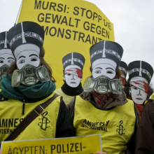 <p>Amnesty International (founded 1961, active worldwide) in collaboration with El Zeft (Egyptian, birthdate unknown). <em>Action against the excessive use of force by Egyptian police against protesters, on the occasion of Mohammed Morsi's state visit outside the Bundeskanzleramt/Paul-Löbe-Haus, Berlin, Germany</em>, January 30, 2013. Documentary photograph. © Amnesty lnternational/EI Zeft</p>