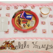 <p>Tracie. <i>Malala Yousafzai Place Setting</i>, from the series <i>Shared Dining</i>, by Women of York, 2015. Courtesy of Susan Meiselas/Three Guineas Fund Project. Photo: © Susan Meiselas</p>
