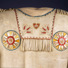 <p>Red River Metis or Yanktonai Sioux artist. <em>Dress Shirt </em>(detail), 19th century. Buckskin, porcupine quills, garnet beads, pony beads, seed beads, thread, 39 in. (99.1 cm). Brooklyn Museum; Henry L. Batterman Fund and Frank Sherman Benson Fund, 50.67.4</p>