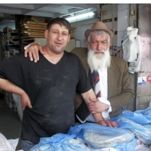 <p>Wendy Ewald (American, born 1951). <em>Untitled</em>, photograph by Oshik, Mahane Yehuda Market, Jerusalem 2012&ndash;13. Archival pigment ink print mounted on aluminum, 5<sup>3</sup>&frasl;<sub>8</sub> x 6<sup>7</sup>&frasl;<sub>8</sub> in. (13.7 x 17.5 cm). &copy; Wendy Ewald, all rights reserved</p>