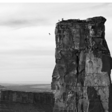<p>Krystle Wright (Australian, born 1987).<em> Freefall, Michael Tomchek leaps off Castleton Tower (400ft) as fellow BASE jumpers look on, Castle Valley, Utah, 2010,</em> printed 2016. Inkjet print, 13<sup>1</sup>&frasl;<sub>4</sub> x 20 in. (33.9 x 50.8 cm). Collection of Krystle Wright</p>