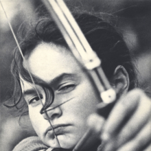<p>Lev Borodulin (Russian, born 1923). <em>Girl Archer,</em> 1956. Vintage photograph, 13<sup>5</sup>⁄<sub>8</sub> x 9<sup>1</sup>⁄<sub>16</sub> in. (34.6 x 23 cm). Copyright Lev Borodulin, courtesy Nailya Alexander Gallery, NYC</p>