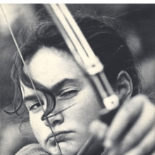 <p>Lev Borodulin (Russian, born 1923). <em>Girl Archer,</em> 1956. Vintage photograph, 13<sup>5</sup>&frasl;<sub>8</sub> x 9<sup>1</sup>&frasl;<sub>16</sub> in. (34.6 x 23 cm). Copyright Lev Borodulin, courtesy Nailya Alexander Gallery, NYC</p>