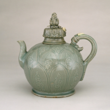 <p><em>Ewer in the Shape of a Lotus Bud</em>. Korea, Goryeo dynasty, first half 12th century. Carved stoneware with slip decoration under celadon glaze, 9<sup>7</sup>/<sub>8</sub> x 9<sup>1</sup>/<sub>2</sub>&nbsp; x 5<sup>1</sup>/<sub>2</sub> in. (25.1 x 24.1 x 14 cm). Brooklyn Museum, Gift of Mrs. Darwin R. James III, 56.138.1a&ndash;b. (Photo: Brooklyn Museum)</p>