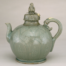 Ewer in the Shape of a Lotus Bud. Korea, Goryeo dynasty, first half 12th century. Carved stoneware with slip decoration under celadon glaze, 97/8 x 91/2  x 51/2 in. (25.1 x 24.1 x 14 cm). Brooklyn Museum, Gift of Mrs. Darwin R. James III, 56.138.1a–b. (Photo: Brooklyn Museum)