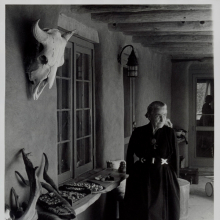 <p>Todd Webb (American, 1905–2000). <em>Georgia O'Keeffe on Ghost Ranch Portal</em>, New Mexico, circa 1960s. Gelatin silver print, 10 x 8 in. (25.4 x 20.3 cm). Georgia O'Keeffe Museum, Santa Fe, N.M.; Gift of The Georgia O'Keeffe Foundation, 2006.06.1046. © Estate of Todd Webb, Portland, ME</p>