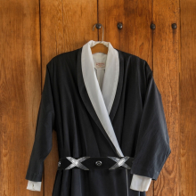 <p>Wrap Dress, circa 1960s–70s. Black cotton. Inner garment: Carol Sarkisian (American, 1936–2013). Wrap dress, circa 1970s. White cotton. Georgia O'Keeffe Museum, Santa Fe, N.M., 2000.03.0601 and 2000.03.0410. (Photo: © Gavin Ashworth)</p>