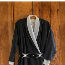 <p>Wrap Dress, circa 1960s&ndash;70s. Black cotton. Inner garment: Carol Sarkisian (American, 1936&ndash;2013). Wrap dress, circa 1970s. White cotton. Georgia O&rsquo;Keeffe Museum, Santa Fe, N.M., 2000.03.0601 and 2000.03.0410. (Photo: &copy; Gavin Ashworth)</p>