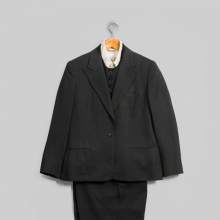 <p>Emsley. Suit (Jacket, Pants, and Vest), 1983. Black wool. Inner garment: Lord & Taylor. Shirt, circa 1960s. White cotton. Georgia O'Keeffe Museum, Santa Fe, N.M.; Gift of Juan and Anna Marie Hamilton, 2000.03.0384, 2000.03.0393, 2000.03.0386, and 2000.03.0239. (Photo: © Gavin Ashworth)</p>