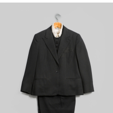 <p>Emsley. Suit (Jacket, Pants, and Vest), 1983. Black wool. Inner garment: Lord &amp; Taylor. Shirt, circa 1960s. White cotton. Georgia O&rsquo;Keeffe Museum, Santa Fe, N.M.; Gift of Juan and Anna Marie Hamilton, 2000.03.0384, 2000.03.0393, 2000.03.0386, and 2000.03.0239. (Photo: &copy; Gavin Ashworth)</p>