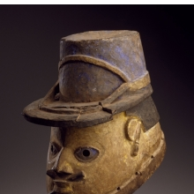 <p>Yoruba artist. <em>Gelede Helmet Mask of a Gendarme</em>, early 20th century. Wood, metal, pigment, 10 x 7 x 11 in. (25.4 x 17.8 x 27.9 cm). Brooklyn Museum; Gift of Eugene and Harriet Becker, 1991.226.3. (Photo: Brooklyn Museum)</p>