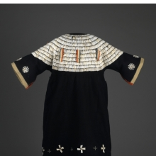 <p>Sioux (Native American) artist. <em>Dress</em>, 1875&ndash;1900. United States. Wool cloth, dentalium shells, ribbon, glass beads, brass bells, cotton, 43<sup>5</sup>/<sub>16 </sub>x 33<sup>7</sup>/<sub>16</sub> in. (110 x 85 cm).<br /> Brooklyn Museum; Charles Stewart Smith Memorial Fund, 46.96.12.<br /> (Photo: Sarah DeSantis, Brooklyn Museum)</p>