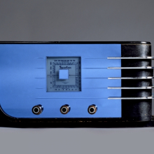 <p>Walter Dorwin Teague (American, 1883‒1960). <em>Sparton Table Radio</em>, circa 1936. Sparks-Withington Co., Jackson, Michigan. Glass, metal, wood, rubber, 8<sup>3</sup>/<sub>4</sub> x 17<sup>1</sup>/<sub>2</sub> x 8<sup>3</sup>/<sub>8</sub> in. (22.2 x 44.5 x 21.3 cm). Brooklyn Museum; Purchased with funds given by the Walter Foundation, 83.158. (Photo: Brooklyn Museum)</p>
