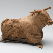 <p><em>Model of a Bull</em>. From Egypt. Third Intermediate Period or Late Period, Dynasty 21‒30, circa 1075–332 <small>B.C.E.</small> Reeds, cloth, 5<sup>11</sup>/<sub>16</sub> x 2<sup>7</sup>/<sub>8</sub> x 9<sup>7</sup>/<sub>16</sub> in. (14.5 x 7.3 x 24 cm). Brooklyn Museum; Charles Edwin Wilbour Fund, 37.1381E. (Photo: Sarah DeSantis, Brooklyn Museum)</p>