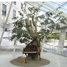 <p>Sanford Biggers (American, born 1970). <em>Blossom</em>, 2007. Steel, plastic and synthetic fibers, wood, MIDI player piano system, Zoopoxy, paint, dirt, modelling clay, polyurethane foam, 12 x 18 x 15 feet (365.9 x 548.8 x 457.3 cm) overall. Brooklyn Museum; Purchase gift of Toby Devan Lewis, Charles and Amber Patton, and an anonymous donor, gift of the Contemporary Art Council, and the Mary Smith Dorward Fund, 2011.10. &copy; Sanford Biggers (Photo: Brooklyn Museum)</p>