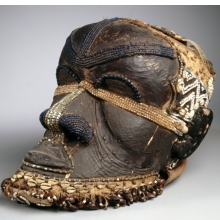 <p>Kuba artist. <em>Bwoom Mask</em>, late 19th or early 20th century. West Kasai Province, Democratic Republic of the Congo. Wood, copper alloy, plant fiber, skin, cowrie shells, seedpods, glass beads, textile, pigments, 13<sup>3</sup>/<sub>4</sub> x 8<sup>1</sup>/<sub>4</sub> x 12 in. (35 x 21 x 30.5 cm). Gift of Mr. and Mrs. John McDonald, 73.178. (Photo: Brooklyn Museum)</p>