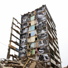 <p>JR (French, born 1983). <em>28 Millimètres, Portrait d'une génération, B11, Destruction #2, Montfermeil, France</em>, 2013. Installation image. Wheat-pasted posters on building. © JR-ART.NET</p>