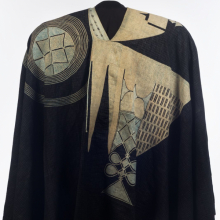 <p>Yorùbá artist. Prestige Robe (<em>agbádá or dàńdógó</em>), 20th century. Nigeria. Cotton, silk, and indigo, 49 × 103 × 2 in. (124.5 × 261.6 × 5.1 cm). Brooklyn Museum; Gift of Dr. and Mrs. Philip Gould, 1991.230.2</p>