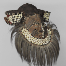 Kuba artist. Mask (Mwaash aMbooy), late 19th or early 20th century. Rawhide, paint, plant fibers, textile, cowrie shells, glass, wood, monkey pelt, feathers, 22 × 20 × 18 in. (55.9 × 50.8 × 45.7 cm). Brooklyn Museum; Robert B. Woodward Memorial Fund, 22.1582. (Photo: Brooklyn Museum)
