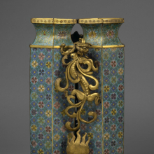 <p><em>Twin Vases with Carved Stand.</em> China, Qing dynasty, 1736–95. Cloisonné enamel on copper alloy, gilt bronze, 25<sup>1</sup>/<sub>4</sub> × 15 × 13 in., 74.5 lb. (64.1 × 38.1 × 33 cm, 33.79 kg). Brooklyn Museum; Gift of Samuel P. Avery, 09.606a–b. (Photo: Brooklyn Museum)</p>