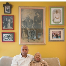 <p>Tarabu Betserai Kirkland at home in Los Angeles with his mother, Mamie Lang Kirkland, 109, who fled Mississippi at age seven. 2017. (Photo: Kris Graves for the Equal Justice Initiative)</p>