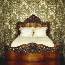<p><em>Bed</em>. John Henry Belter (American, born Germany, 1804-1863). New York, circa 1856. Rosewood, 65<sup>1</sup>&frasl;<sub>2</sub> x 58<sup>1</sup>&frasl;<sub>2</sub> x 83 in. (166.4 &times; 148.6 &times; 210.8 cm). Brooklyn Museum, Gift of Mrs. Ernest Vietor, 39.30</p>