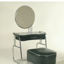 <p><em>Vanity with Mirror and Stool</em>. Kem Weber (American, b. Germany, 1889&ndash;1963). Made by Lloyd Manufacturing Company. Menominee, Michigan, 1934. Chrome-plated tubular steel, wood, glass, upholstery, vanity: 55 &times; 33 &times; 191&frasl;2 in. (139.7 &times; 83.8 &times; 49.5 cm), stool: 17<sup>1</sup>&frasl;<sub>2</sub> x 21 &times; 22<sup>1</sup>&frasl;<sub>2</sub> in. (44.5 &times; 53.3 &times; 57.2 cm). Brooklyn Museum, Modernism Benefit Fund, 87.123.1a&ndash;b and 87.123.2</p>
